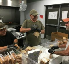 Neighbors making sandwiches for Mobile Loaves food truck